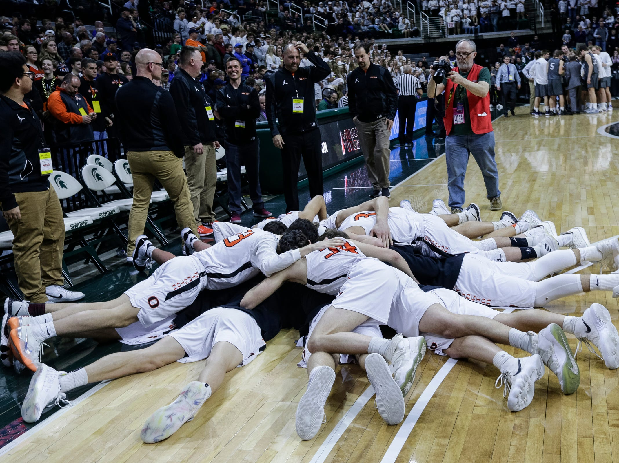 Ludington players huddle before the first half of MHSAA Division 2 semifinal against Hudsonville Unity Christian at the Breslin Center in East Lansing, Friday, March 15, 2019.