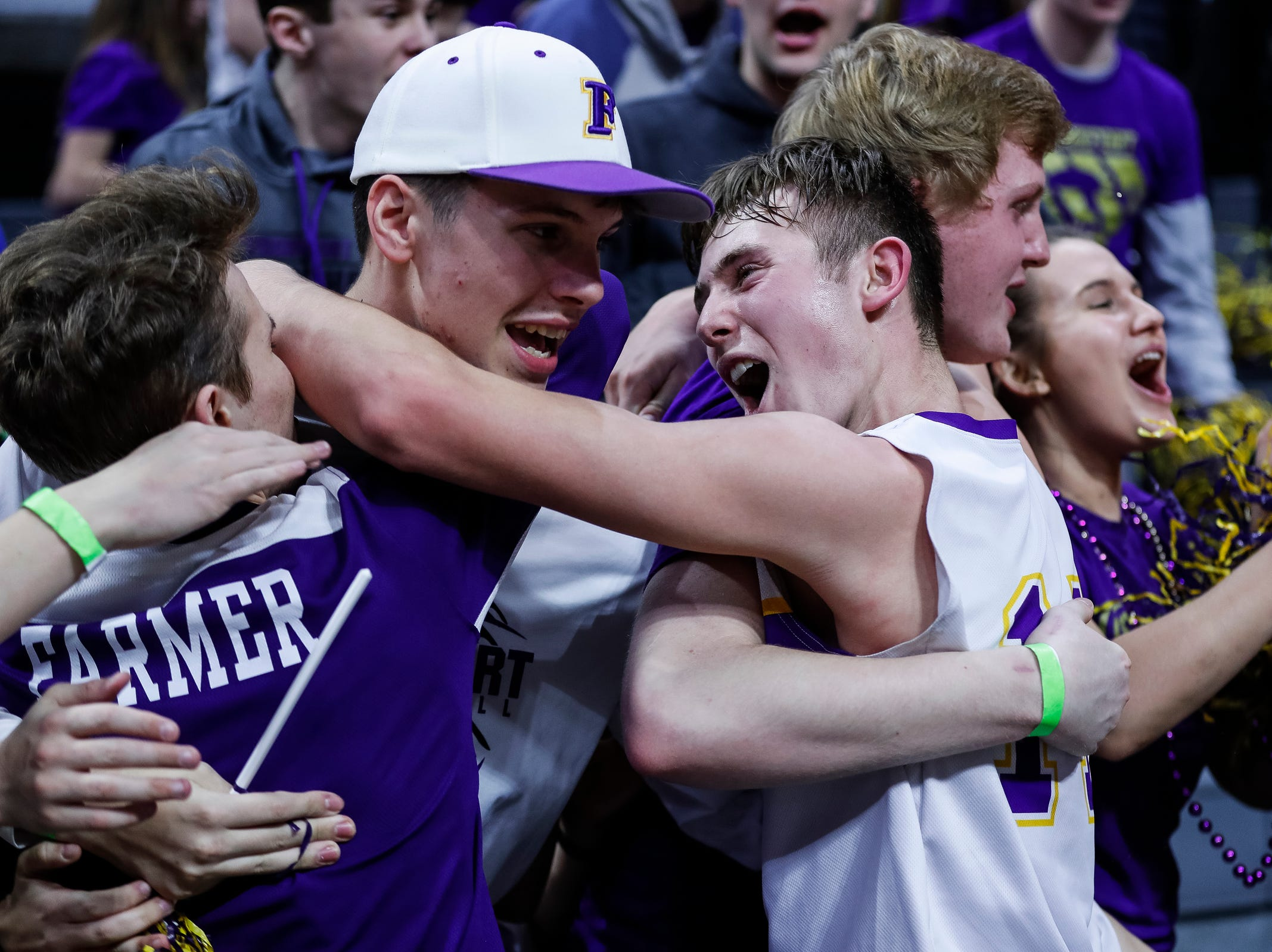 Frankfort players and fans celebrate their 44-43 win over Wyoming Tri-unity Christian at the MHSAA Division 4 semifinal at the Breslin Center in East Lansing, Thursday, March 14, 2019.