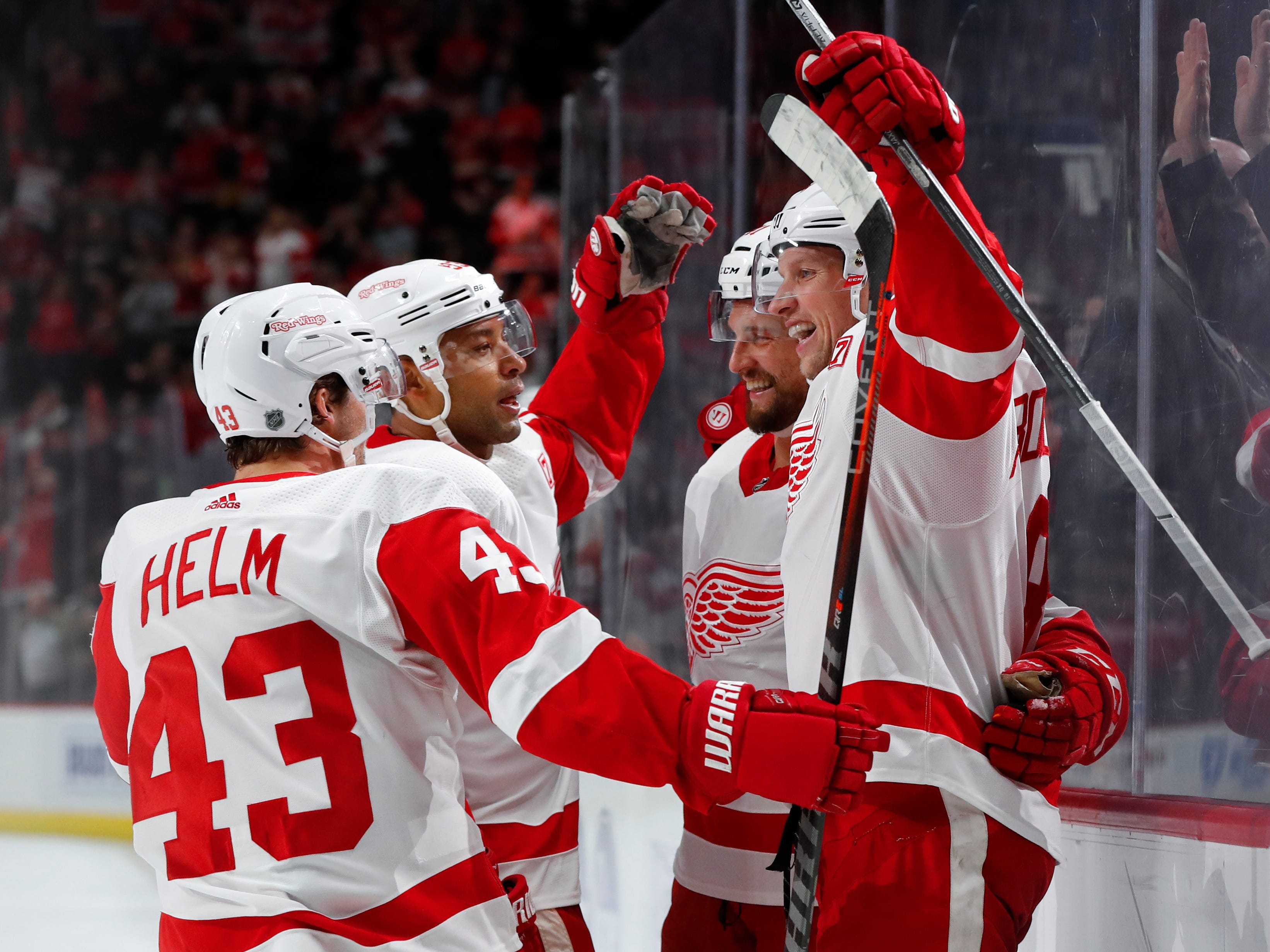 Detroit Red Wings left wing Justin Abdelkader, from right, celebrates his goal with Luke Glendening, Trevor Daley and Darren Helm (43) in the second period of an NHL hockey game against the Tampa Bay Lightning, Thursday, March 14, 2019, in Detroit.