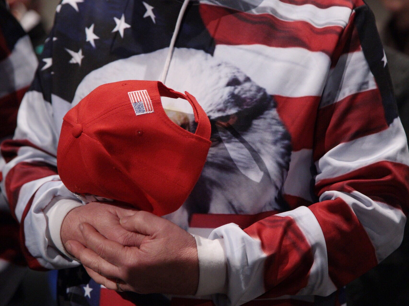 "Tony Mazzorana of Roseville holds his hat during national anthem during Steve Bannon's nationwide tour stop named ""We Build the Wall"" in support Trump's wish for $7-billion expansion of border wall with Mexico, aimed at stopping illegal immigration on Thursday, March 14, 2019 at Cobo Center in downtown Detroit."