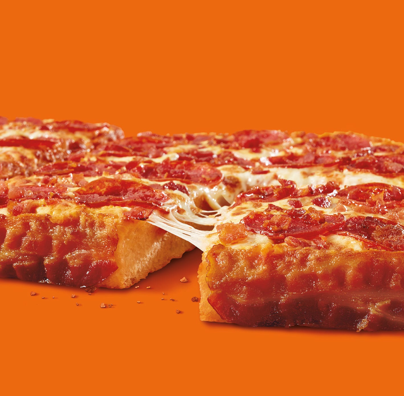 Bacon-wrapped deep-dish pizza is back at Little Caesars