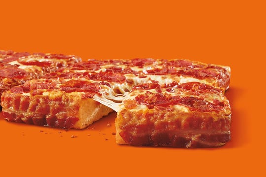 Little Caesars is bringing back its deep dish pizza wrapped in 3 1/2 feet of bacon