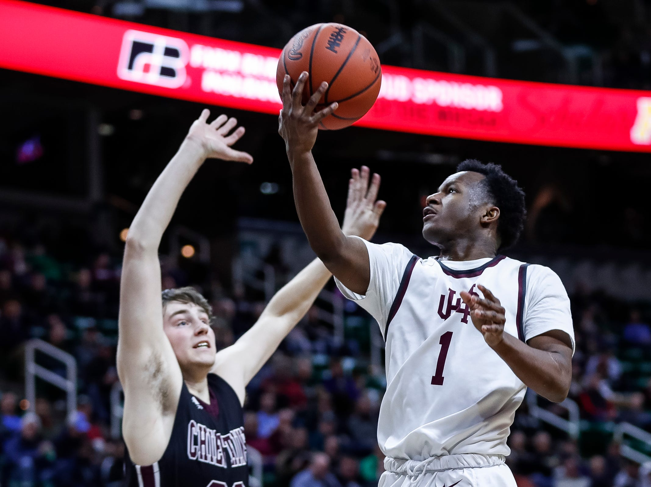 U-D Jesuit's Julian Dozier (1) makes a layup against Okemos during the second half of MHSAA Division 1 semifinal at the Breslin Center in East Lansing, Friday, March 15, 2019.