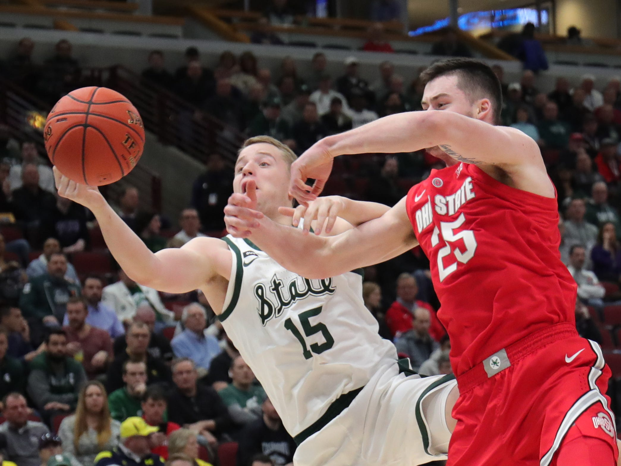 Michigan State forward Thomas Kithier rebounds against Ohio State forward Kyle Young during the first half of the Big Ten tournament Friday, March 15, 2019 at the United Center in Chicago.