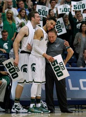 Senior guard Denzel Valentine made sure Tom Izzo got his 500th win, putting up a triple-double in Fullerton, Calif., then gave his coach a hug after the game as Matt Costello, left, looked on.