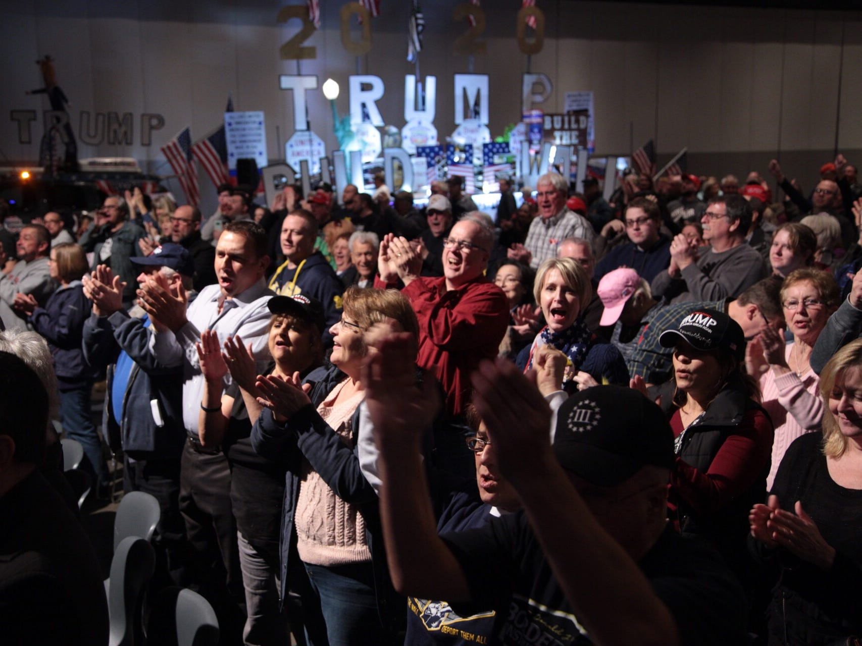 """Supporters cheer during Steve Bannon's nationwide tour stop named """"We Build the Wall"""" in support Trump's wish for $7-billion expansion of border wall with Mexico, aimed at stopping illegal immigration on Thursday, March 14, 2019 at Cobo Center in downtown Detroit."""