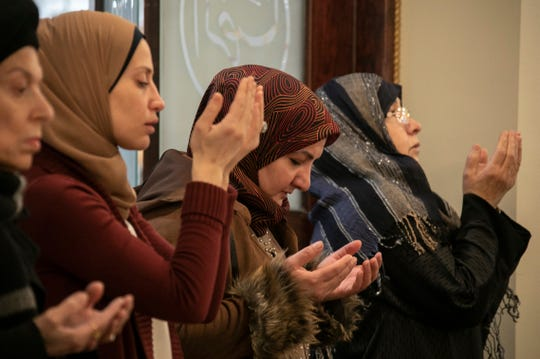 Women pray as Imam Mohammad Ali Elahi addresses the mass shooting at two mosques in New Zealand during prayers at The Islamic House of Wisdom in Dearborn Heights on Friday, March 15, 2019.