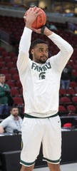 Michigan State forward Nick Ward warms up before action against Ohio State in the Big Ten tournament Friday, March 15, 2019 at the United Center in Chicago, Ill.