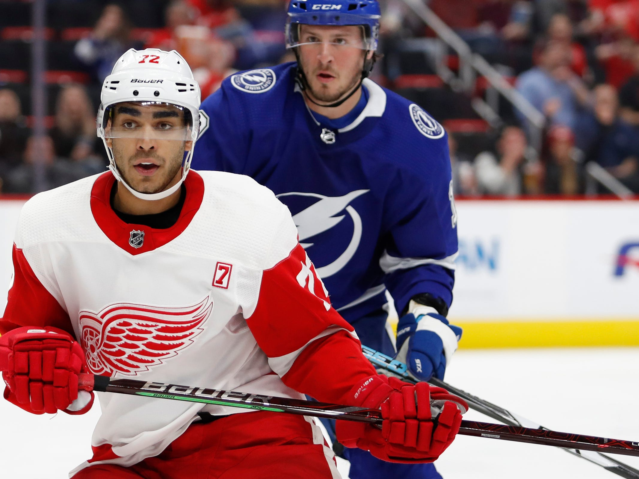 Detroit Red Wings center Andreas Athanasiou (72) gets position in front of Tampa Bay Lightning center J.T. Miller (10) during the second period at Little Caesars Arena on Thursday, March 14, 2019, in Detroit.
