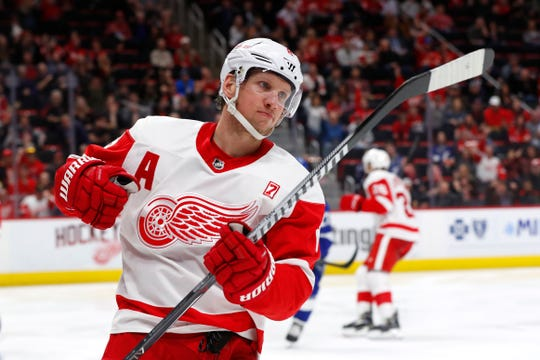 Detroit Red Wings left wing Justin Abdelkader celebrates his goal against the Tampa Bay Lightning in the second period of an NHL hockey game, Thursday, March 14, 2019, in Detroit.