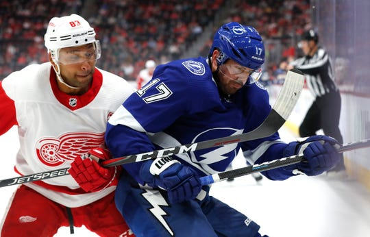 Detroit Red Wings defenseman Trevor Daley (83) and Tampa Bay Lightning left wing Alex Killorn (17) battle for the puck in the first period of an NHL hockey game, Thursday, March 14, 2019, in Detroit.