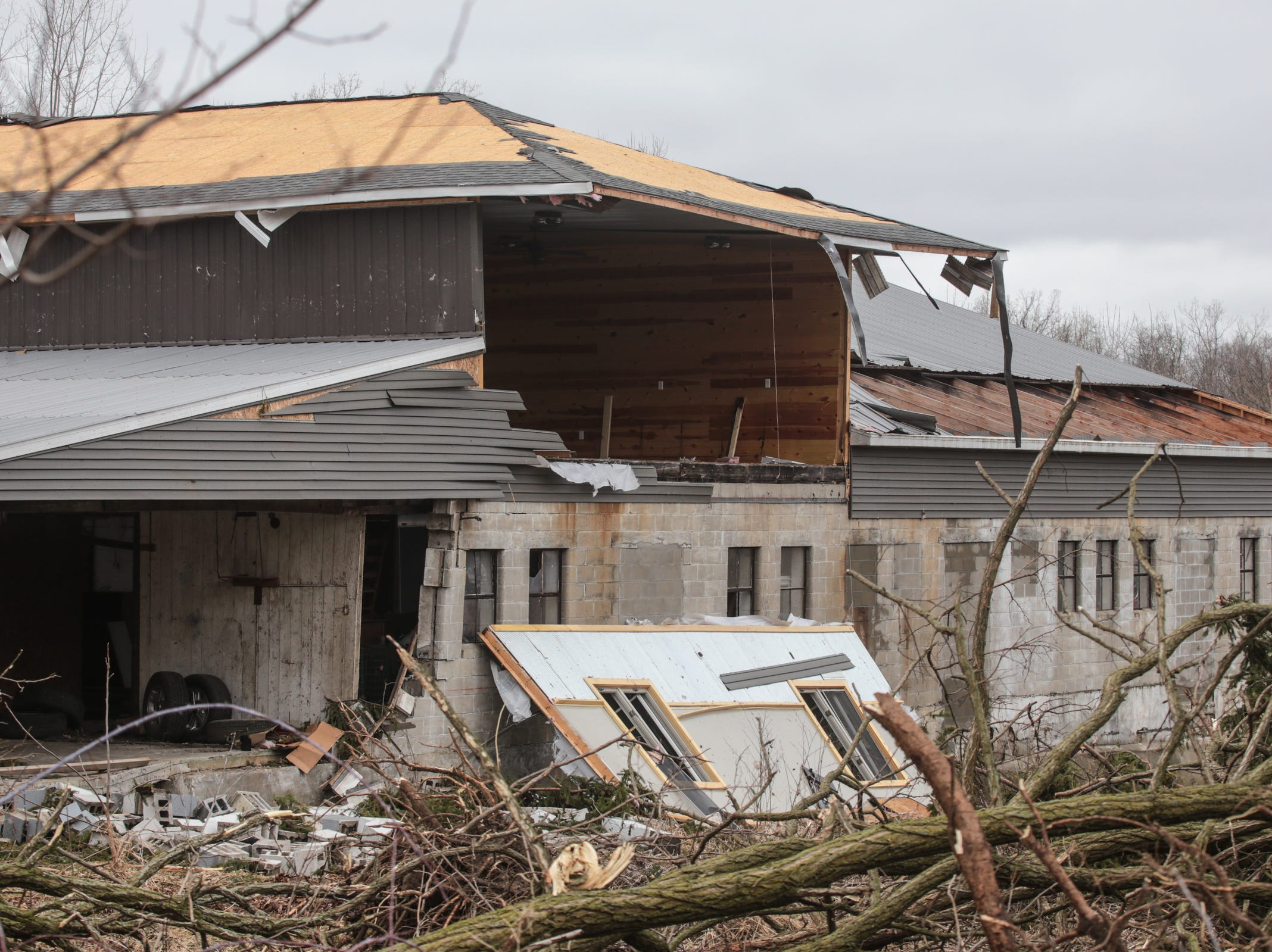 A structure shows damage from a tornado that came through Shiawassee County overnight on Newburg Rd.in Bancroft on Friday, March 15, 2019.
