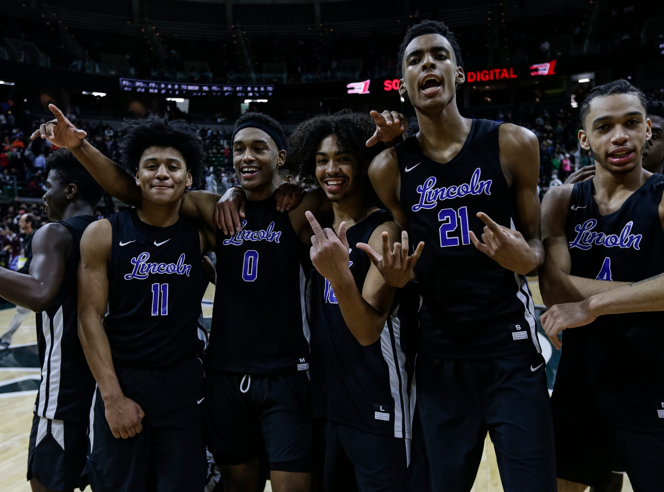 Ypsilanti Lincoln players celebrate after the Railsplitters won 72-56 over Howell at MHSAA Division 1 semifinal at the Breslin Center in East Lansing, Friday, March 15, 2019.