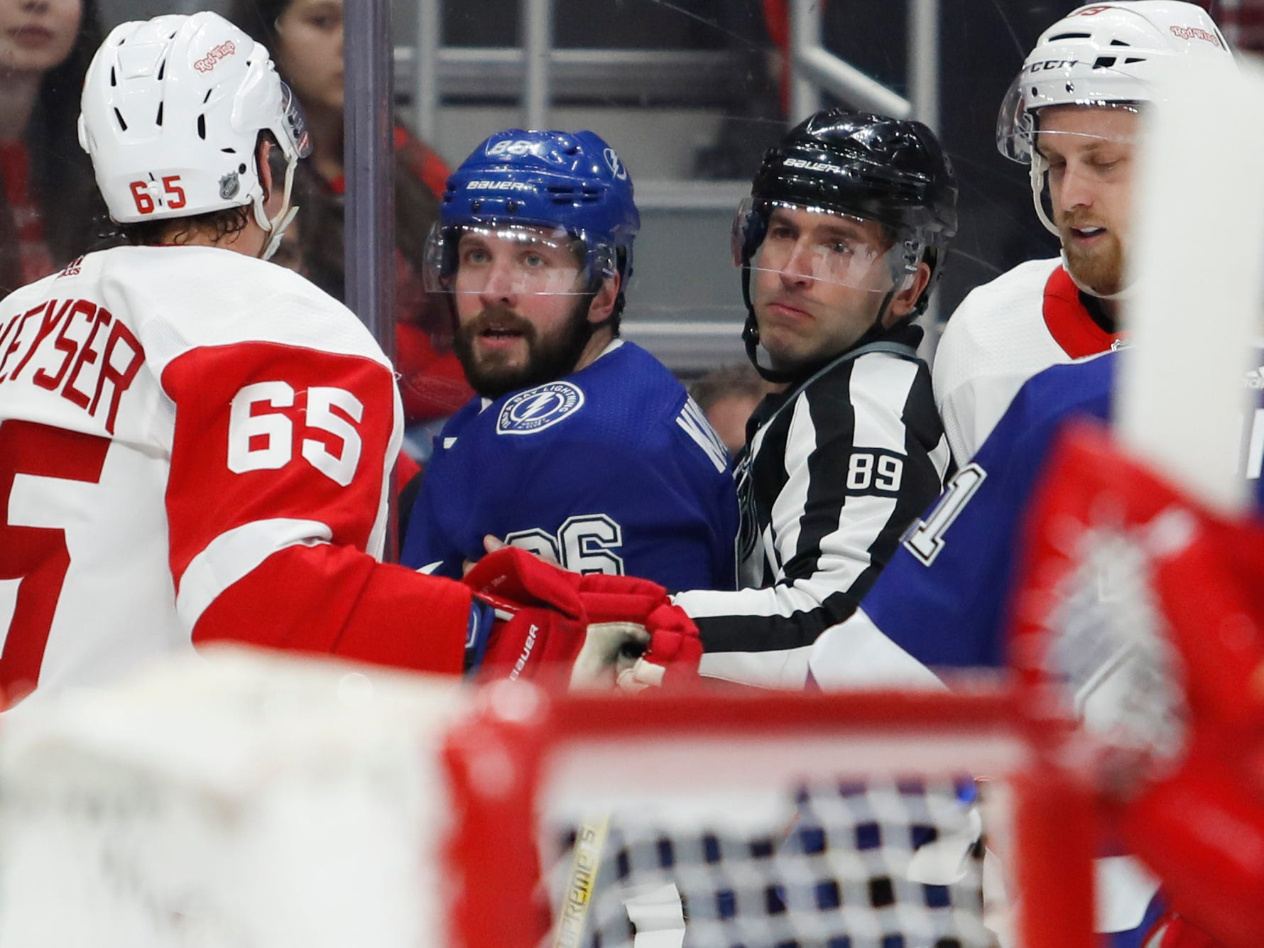 Tampa Bay Lightning right wing Nikita Kucherov (86) and Detroit Red Wings defenseman Danny DeKeyser (65) get into a shoving match during the first period at Little Caesars Arena on Thursday, March 14, 2019, in Detroit.
