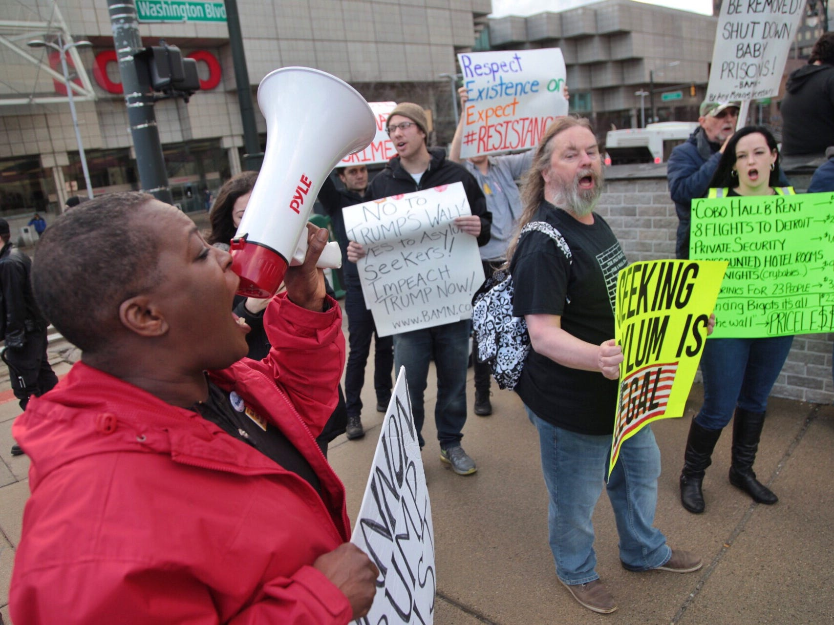 """Protestors chant before Steve Bannon's nationwide tour stop named """"We Build the Wall"""" in support Trump's wish for $7-billion expansion of border wall with Mexico, aimed at stopping illegal immigration on Thursday, March 14, 2019 at Cobo Center in downtown Detroit."""