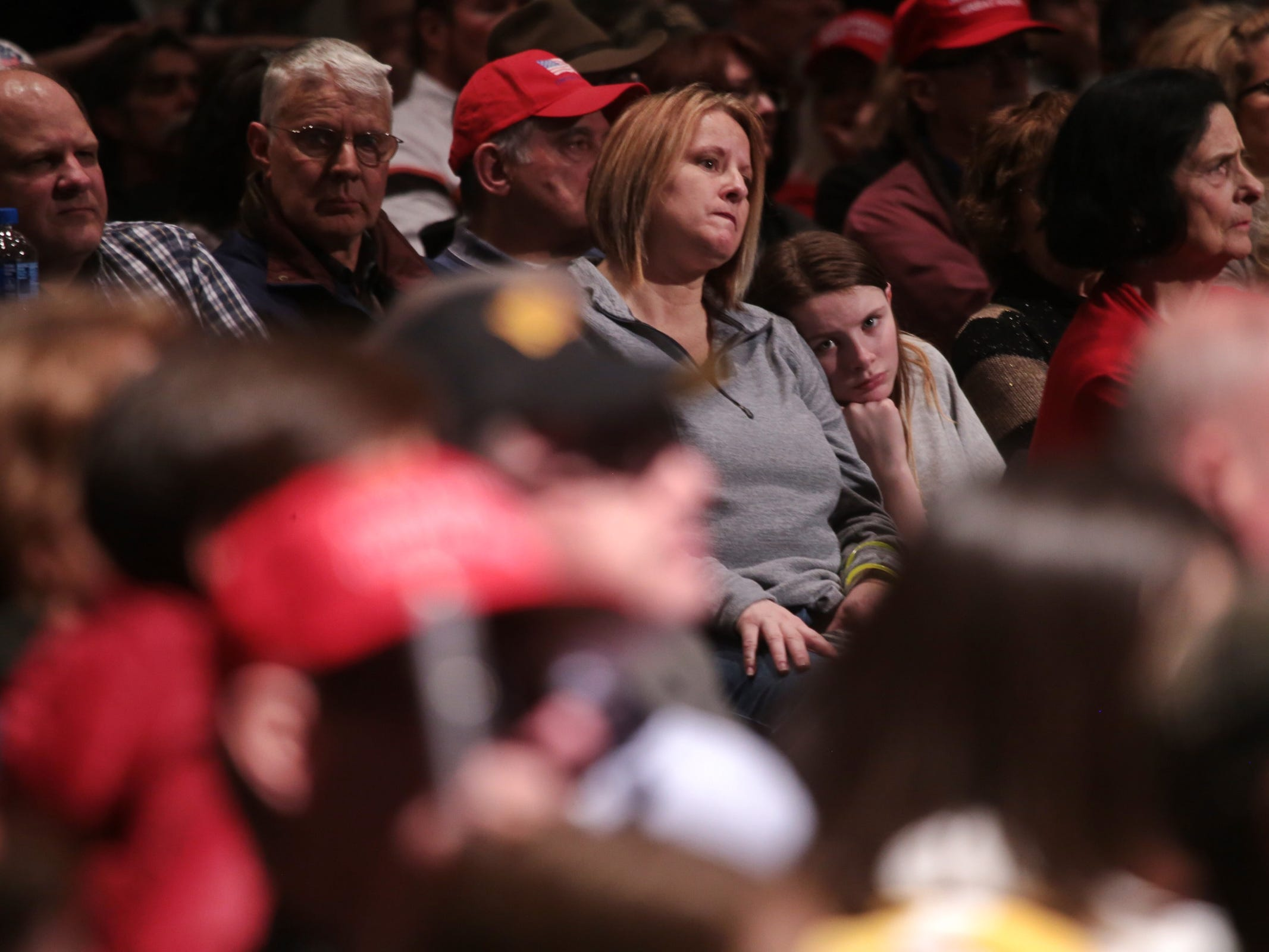 "Supporters listen to a speaker during Steve Bannon's nationwide tour stop named ""We Build the Wall"" in support Trump's wish for $7-billion expansion of border wall with Mexico, aimed at stopping illegal immigration on Thursday, March 14, 2019 at Cobo Center in downtown Detroit."