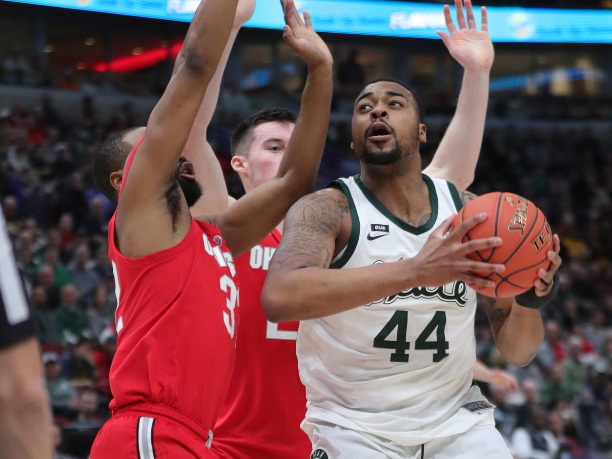 Michigan State forward Nick Ward drives against Ohio State's C.J. Jackson and Kyle Young during first half action of the Big Ten tournament Friday, March 15, 2019 at the United Center in Chicago, Ill.