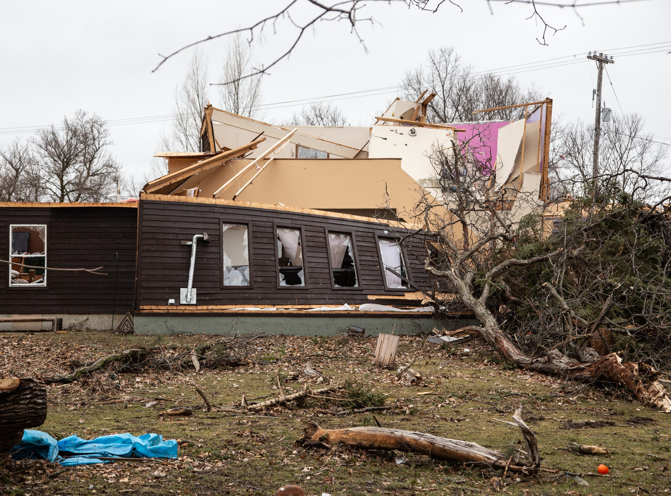 A home shows damage from a tornado that came through Shiawassee County overnight on Newburg Rd. in Bancroft on Friday, March 15, 2019.