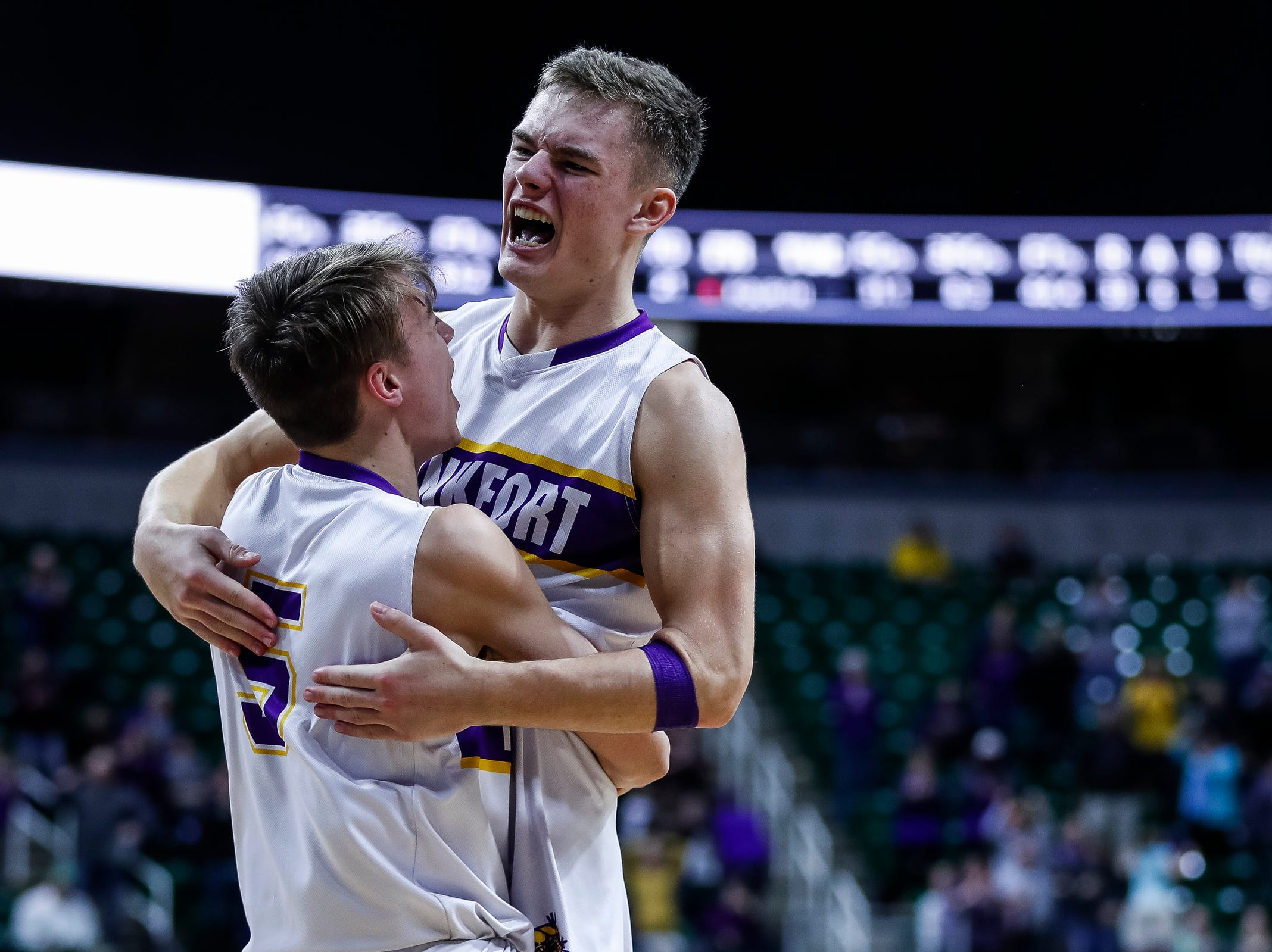 Frankfort's Conner Smith (15) and Luke Hammon (5) celebrate the Panthers' 44-43 win over Wyoming Tri-unity Christian during the second half of MHSAA Division 4 semifinal at the Breslin Center in East Lansing, Thursday, March 14, 2019.