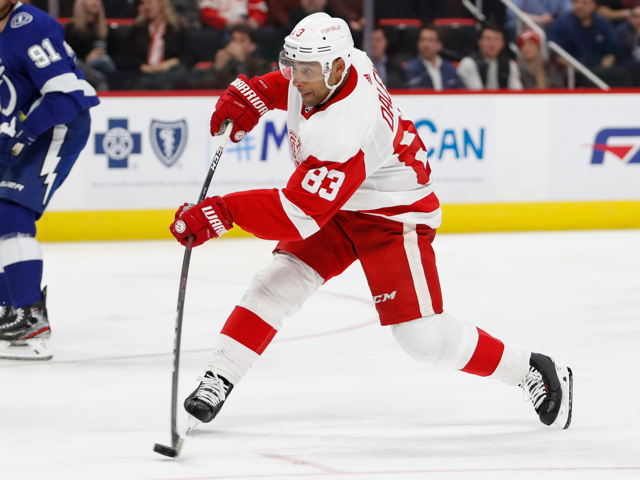 Detroit Red Wings defenseman Trevor Daley (83) takes a shot during the second period against the Tampa Bay Lightning at Little Caesars Arena on Thursday, March 14, 2019, in Detroit.
