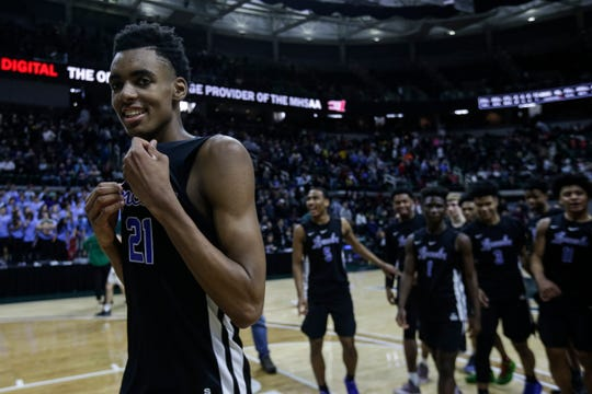 Ypsilanti Lincoln's Emoni Bates (21) walks off the court after the Railsplitters won 72-56 over Howell at MHSAA Division 1 semifinal at the Breslin Center in East Lansing, Friday, March 15, 2019.