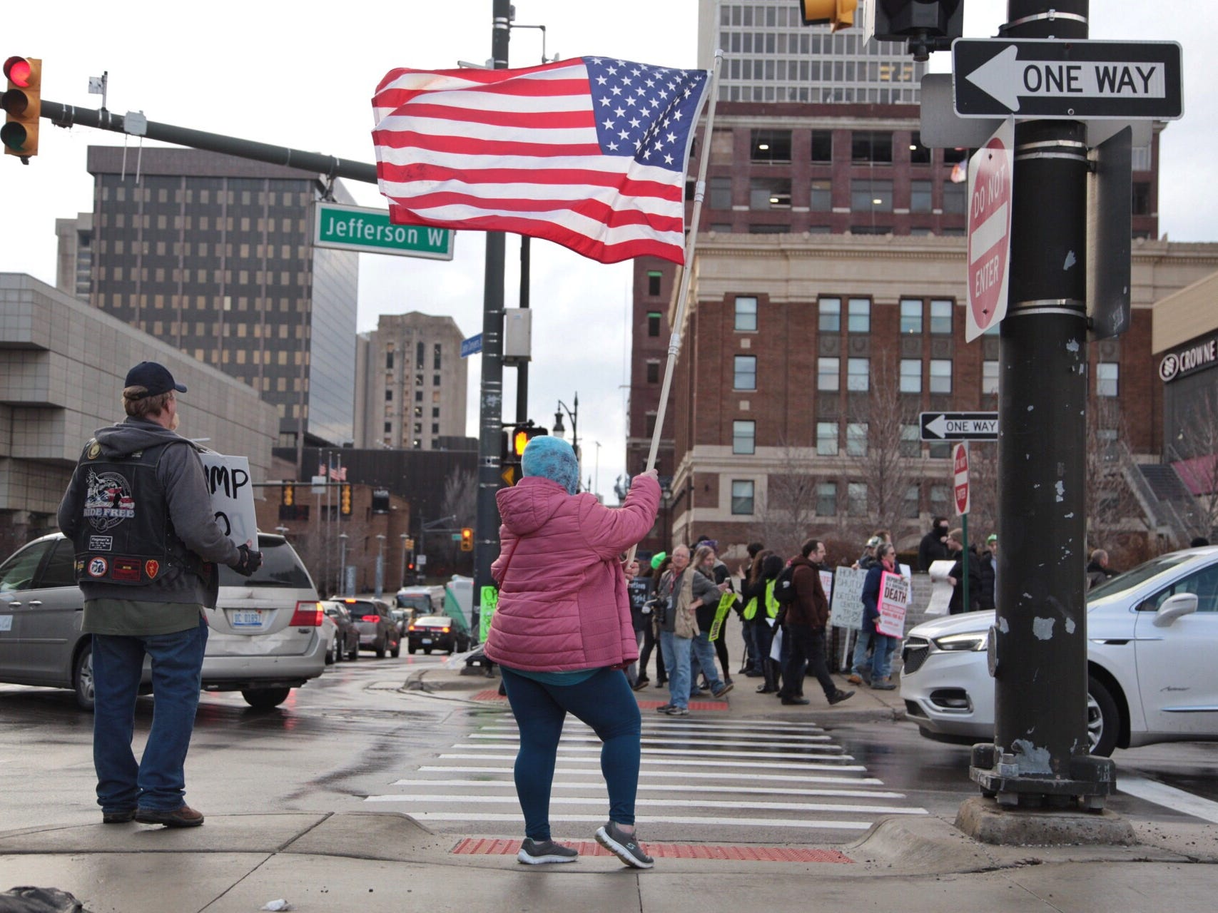 """Supporters stand across from a group of protestors during Steve Bannon's nationwide tour stop named """"We Build the Wall"""" in support Trump's wish for $7-billion expansion of border wall with Mexico, aimed at stopping illegal immigration on Thursday, March 14, 2019 at Cobo Center in downtown Detroit."""