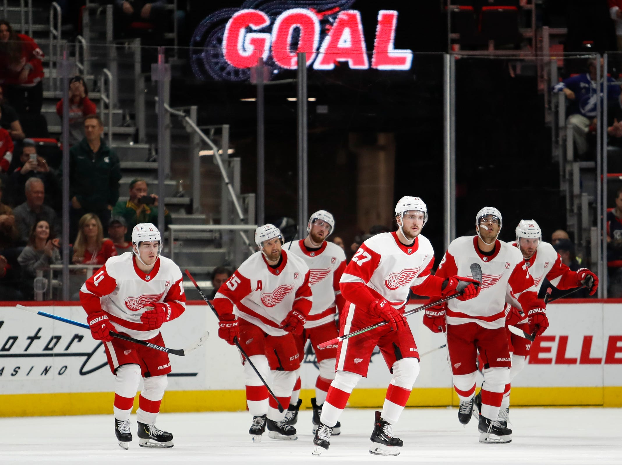 Red Wings center Michael Rasmussen (27) celebrates after scoring a goal during the third period of the Wings' 5-4 loss to the Lightning on Thursday, March 14, 2019, at Little Caesars Arena.
