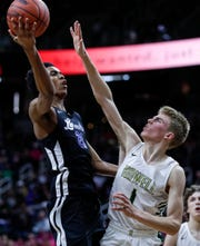 Ypsilanti Lincoln's Emoni Bates (21) shoots against Howell's Jake Sargeant (1) during the second  half of MHSAA Division 1 semifinal at the Breslin Center in East Lansing, Friday, March 15, 2019.