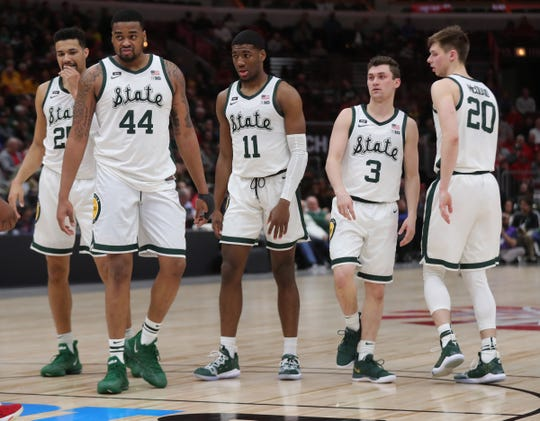 Michigan State's Kenny Goins, Nick Ward, Aaron Henry, Foster Loyer and Matt McQuaid on the floor during the first half against Ohio State, Friday, March 15, 2019 at the United Center in Chicago, Ill.