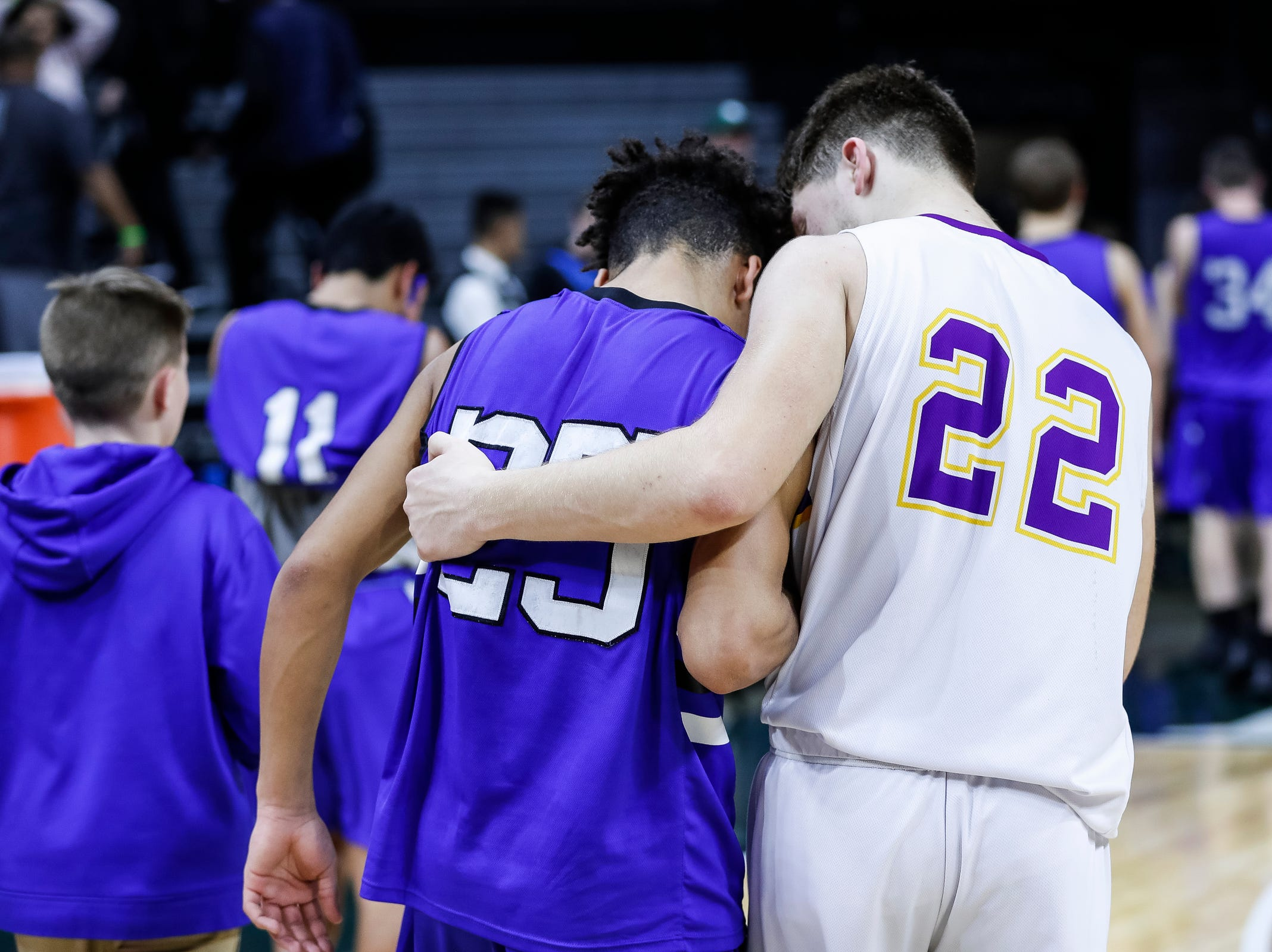 Wyoming Tri-unity Christian's Brady Titus (25) is comforted by Frankfort's Ethan Ness (22) after the MHSAA Division 4 semifinal at the Breslin Center in East Lansing, Thursday, March 14, 2019.