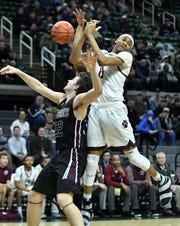 U-D Jesuit's Jalen Thomas battles Okemos' Mason Caczmarek for the ball in the second half.