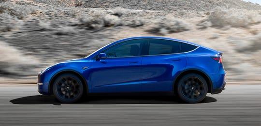 Revealed: Tesla raises curtain on Model Y compact SUV