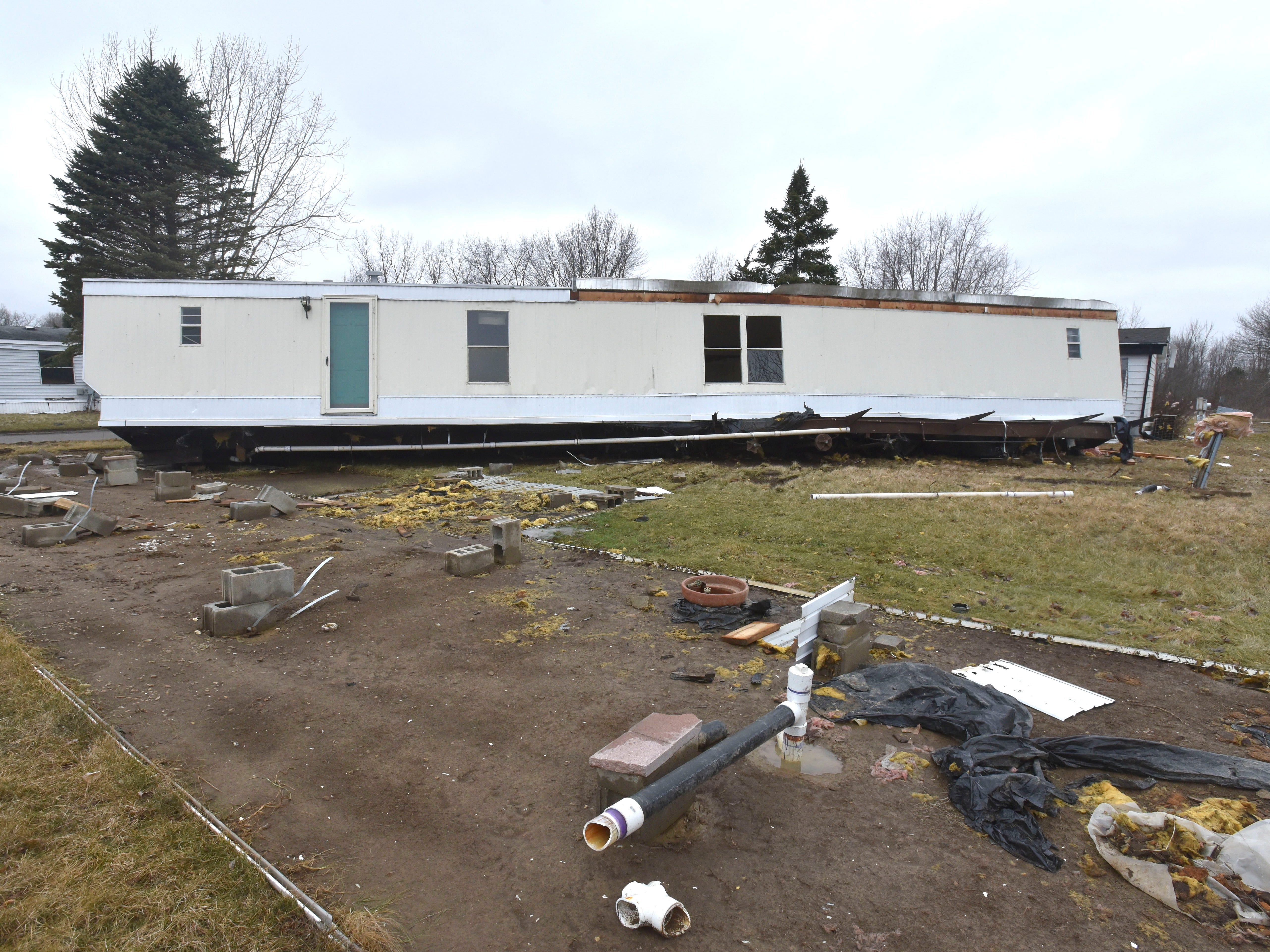 This mobile home at the at the Camelot Villa mobile home park in Mount Morris in Genesee County was lifted off its foundation.  No injuries were reported.