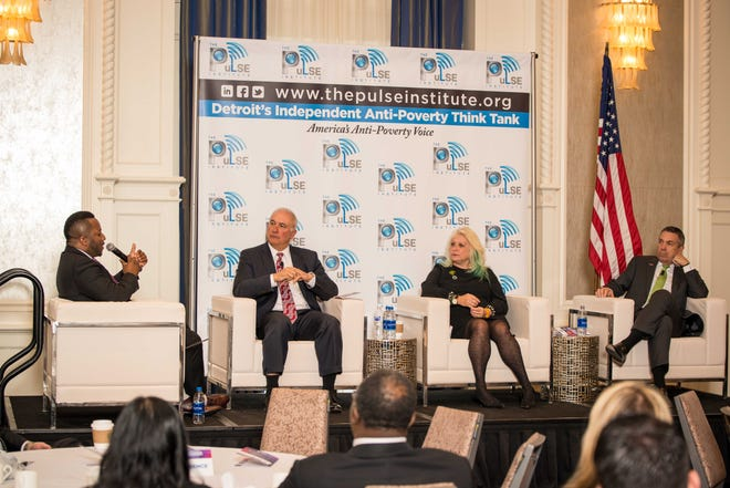 Jerry Norcia, left, president & COO of DTE Energy, Cindy Pasky, president & CEO of Strategic Staffing Solutions and Alessandro DiNello, president & CEO of Flagstar Bank speak at The PuLSE Institute poverty forum moderated by Bankole Thompson.