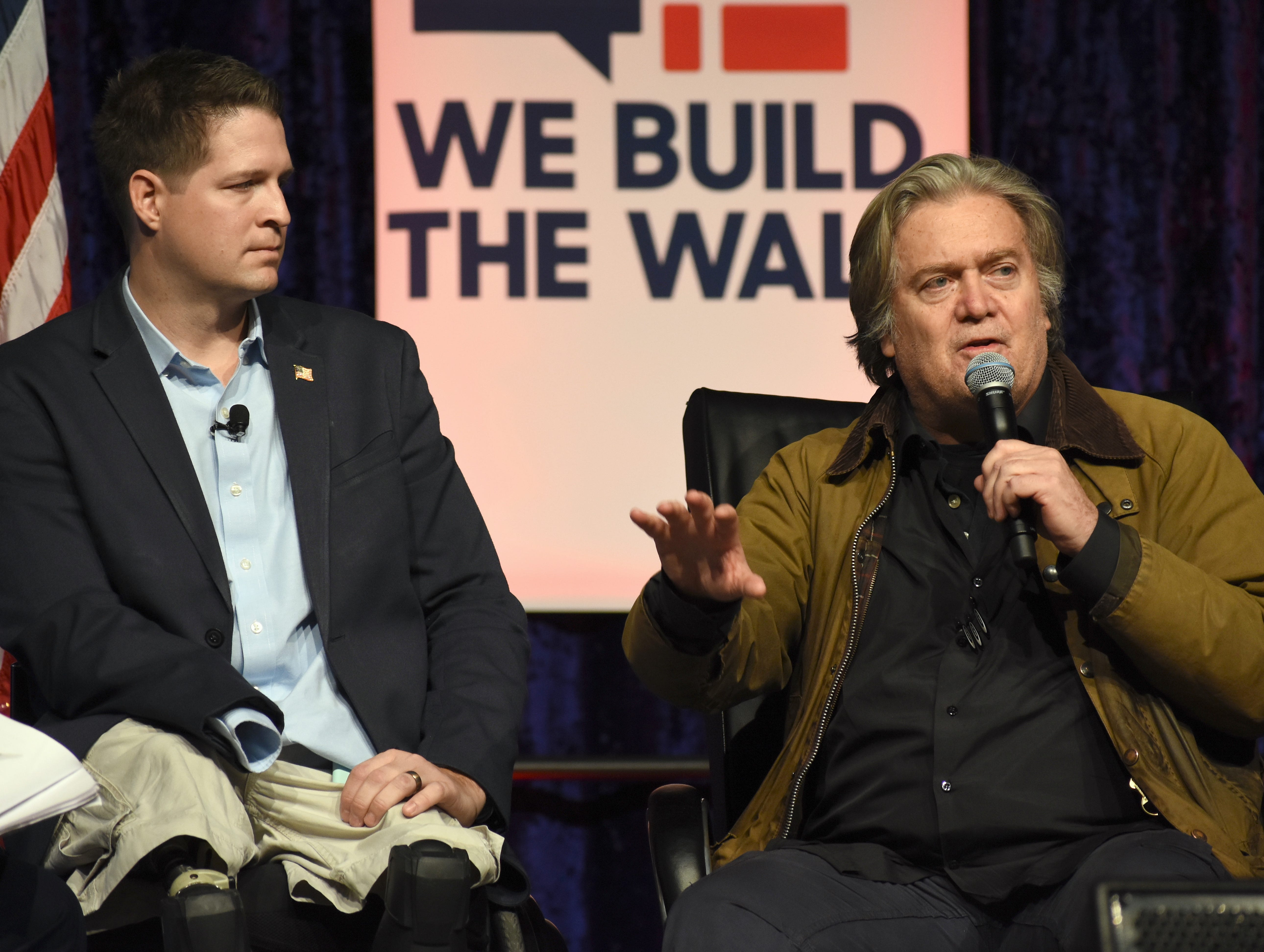 "Several hundred supporters gather to listen to speakers like former White House chief strategist Steve Bannon and Brian Kolfage, left, a triple amputee veteran who organized a private fundraising campaign to finance the border wall, at a ""We Build The Wall"" town hall meeting."