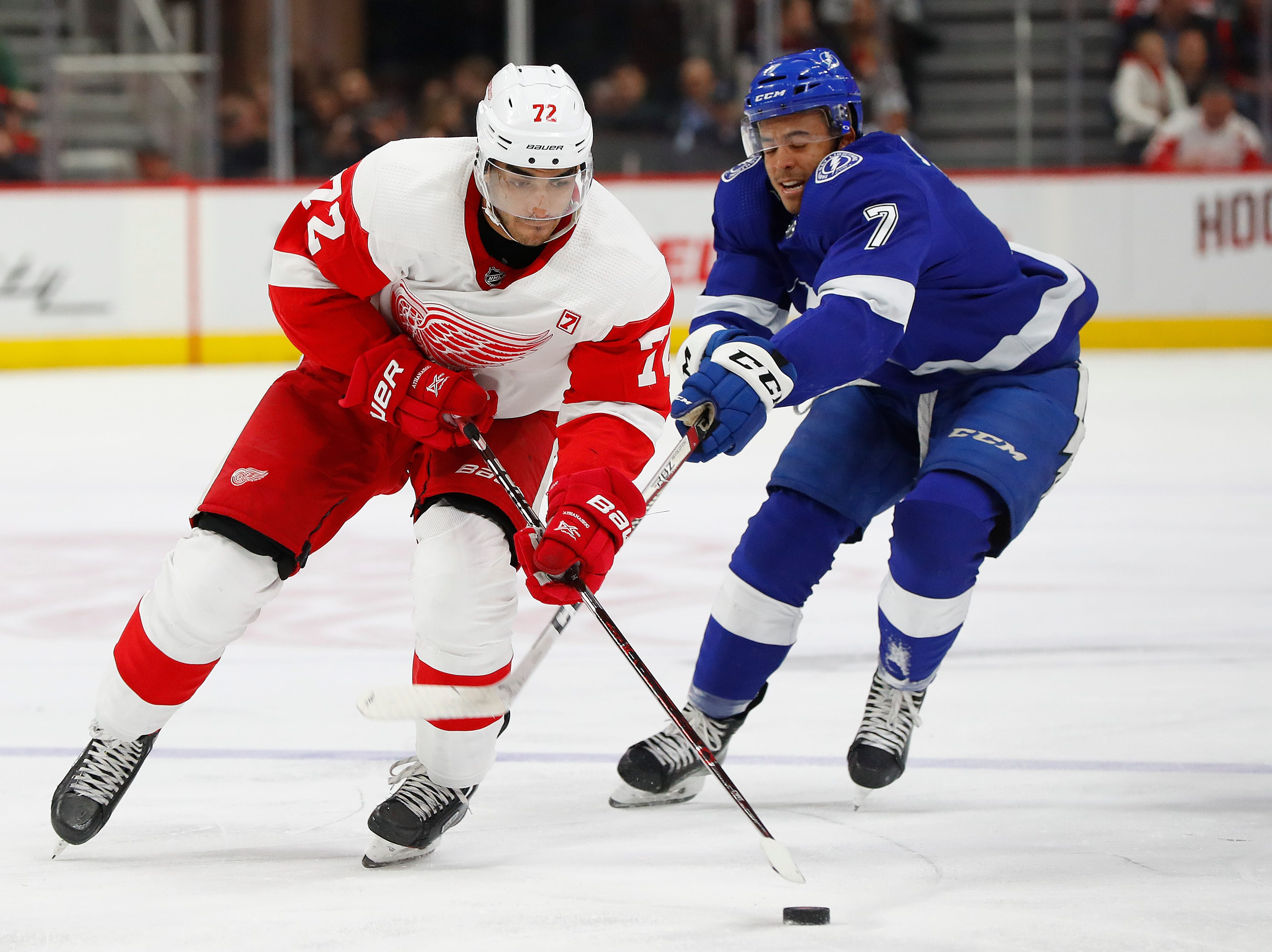 Detroit Red Wings center Andreas Athanasiou (72) skates with the puck as Tampa Bay Lightning's Mathieu Joseph (7) defends in the second period.