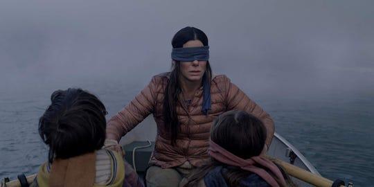 "Sandra Bullock, Julian Edwards, and Vivien Lyra Blair in ""Bird Box."""