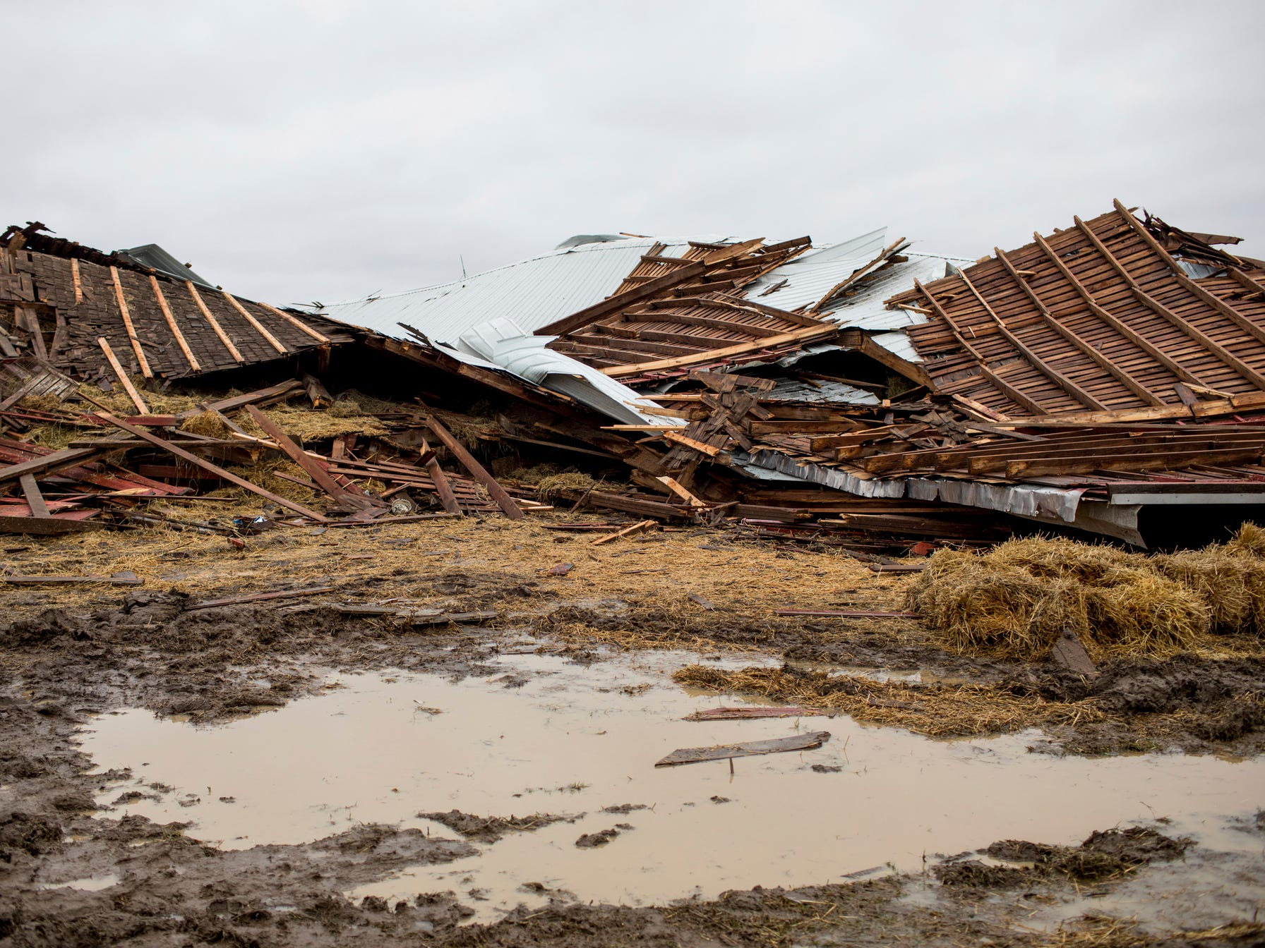 Debris lies on the ground after a barn was destroyed by a tornado Friday in Vernon.
