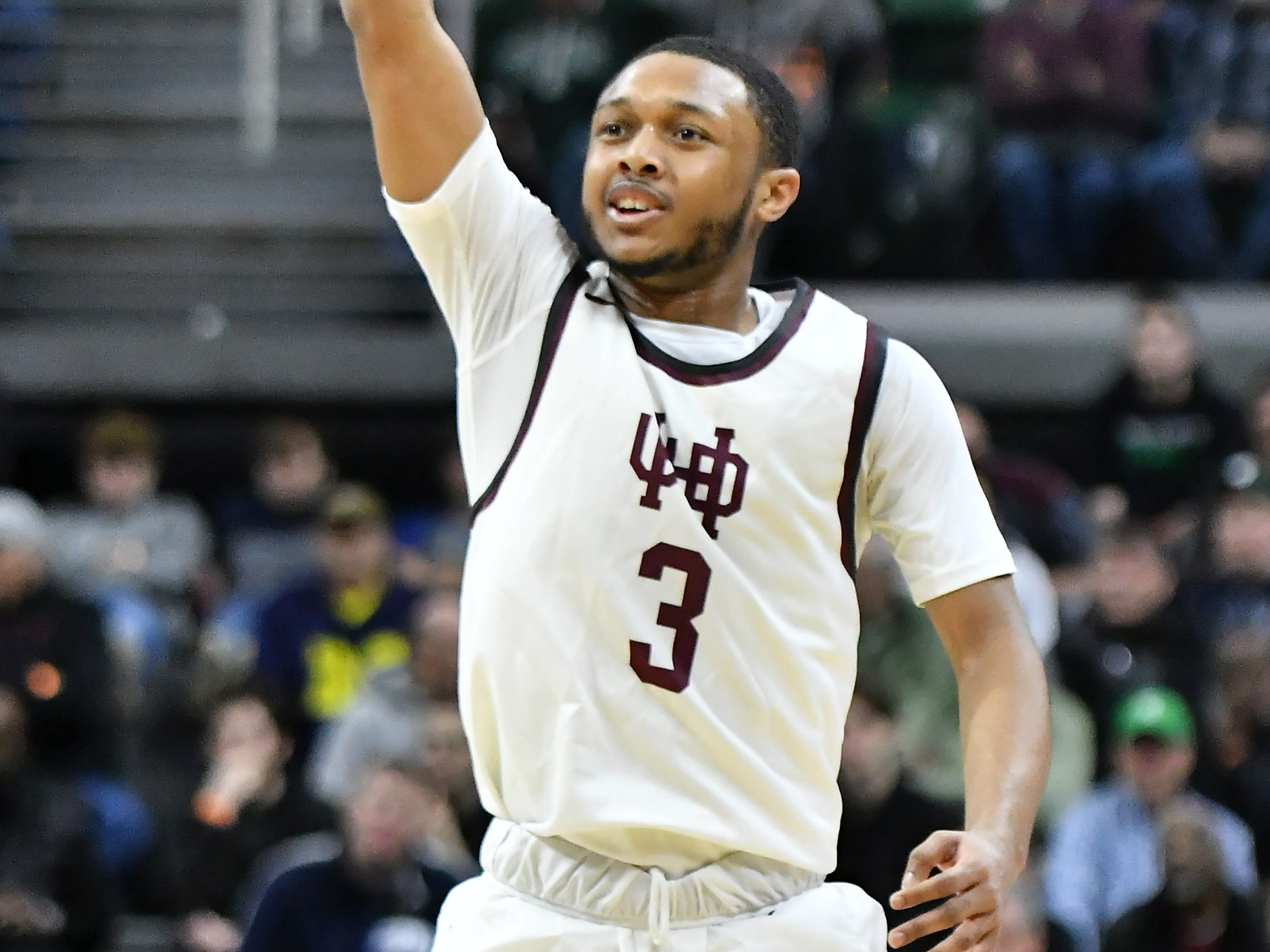 U-D Jesuit's Jordan Montgomery (3) reacts after hitting a three-pointer in the second half.