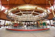 Some figures have been removed from the historic carousel at Dearborn's Greenfield Village for restoration.