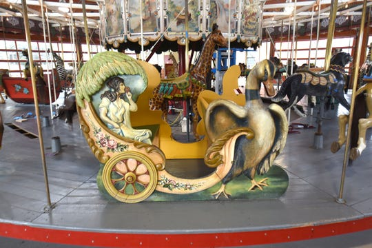 Elaborately designed stationary seats on Greenfield Village's carousel are also undergoing restoration.