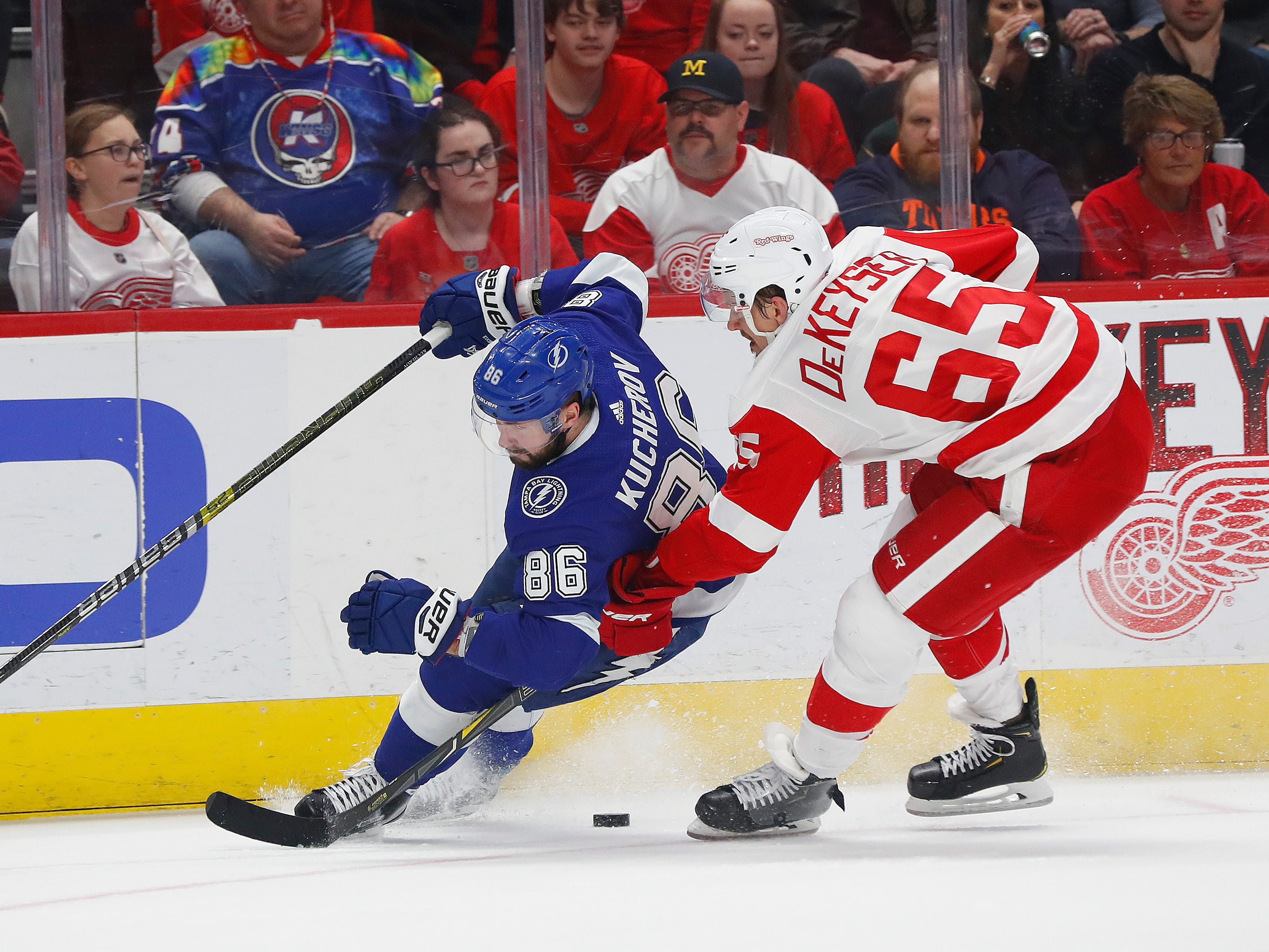 Detroit Red Wings defenseman Danny DeKeyser (65) knocks Tampa Bay Lightning right wing Nikita Kucherov (86) off the puck in the first period.