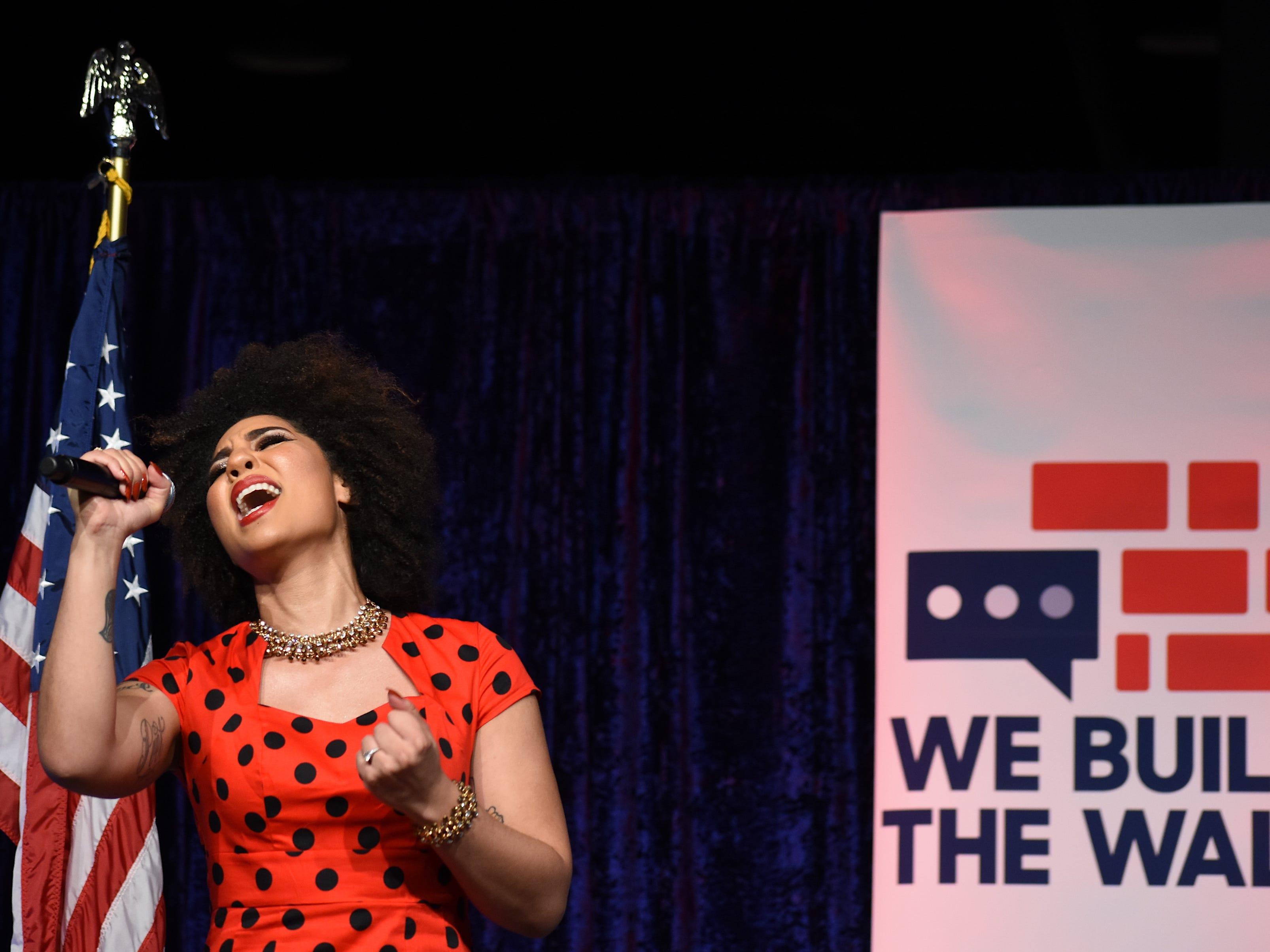 Singer Joy Villa belts out the national anthem.