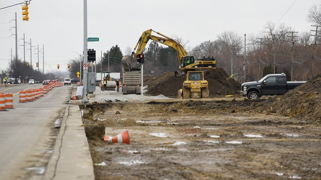 A operator from Iafrate Construction Co. uses an excavator to remove soil from land on St. Jean near E. Canfield in Detroit Friday morning, March 15. The land is part of the 200 acres that the city needs to acquire for the proposed Fiat Chrysler Mack Avenue Assembly complex.