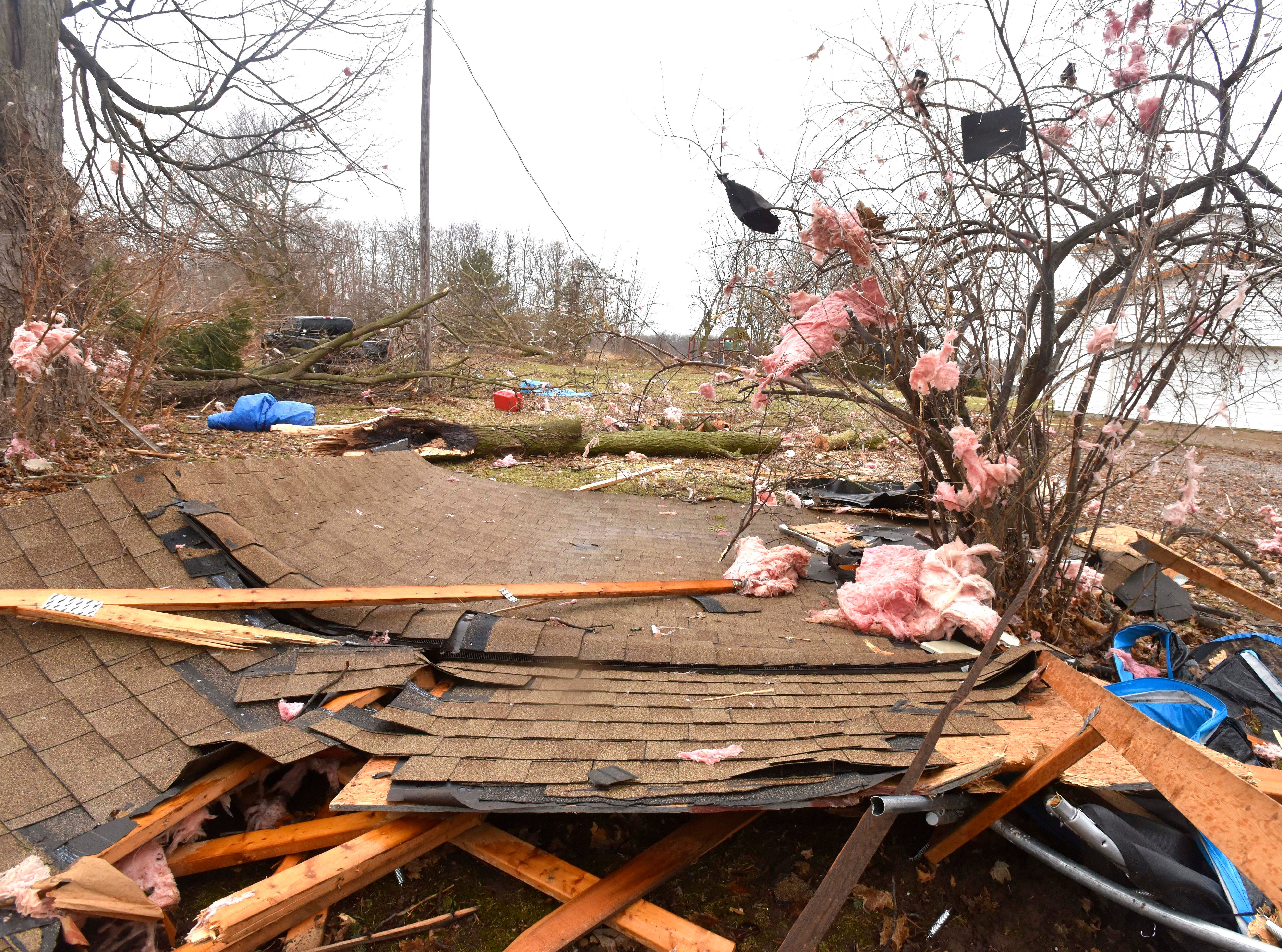 The collapsed roof of a house in Vernon Twp. is seen on the ground with insulation scattered in the trees.damaged by what is believed to have been straight-line winds, the weather service said. Four of the trailers were blown off their foundations, with one of the trailers, that has been vacant for at least a year-and-a-half, wrapped around a tree.
