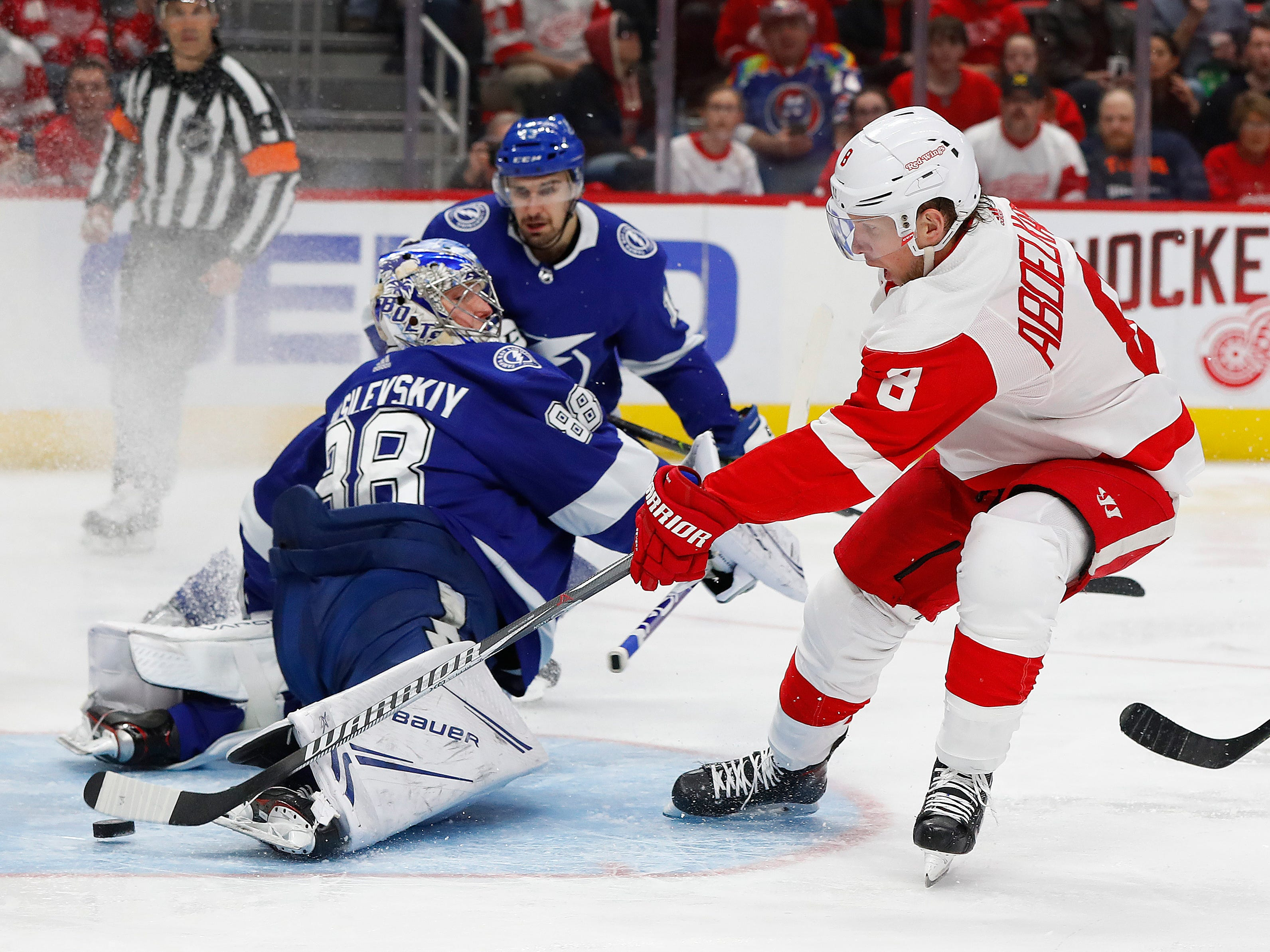 Detroit Red Wings left wing Justin Abdelkader (8) scores on Tampa Bay Lightning goaltender Andrei Vasilevskiy (88) in the second period on Thursday, March 14, 2019, in Detroit, Michigan.  In the end, the LIghtning beat Detroit 5-4.