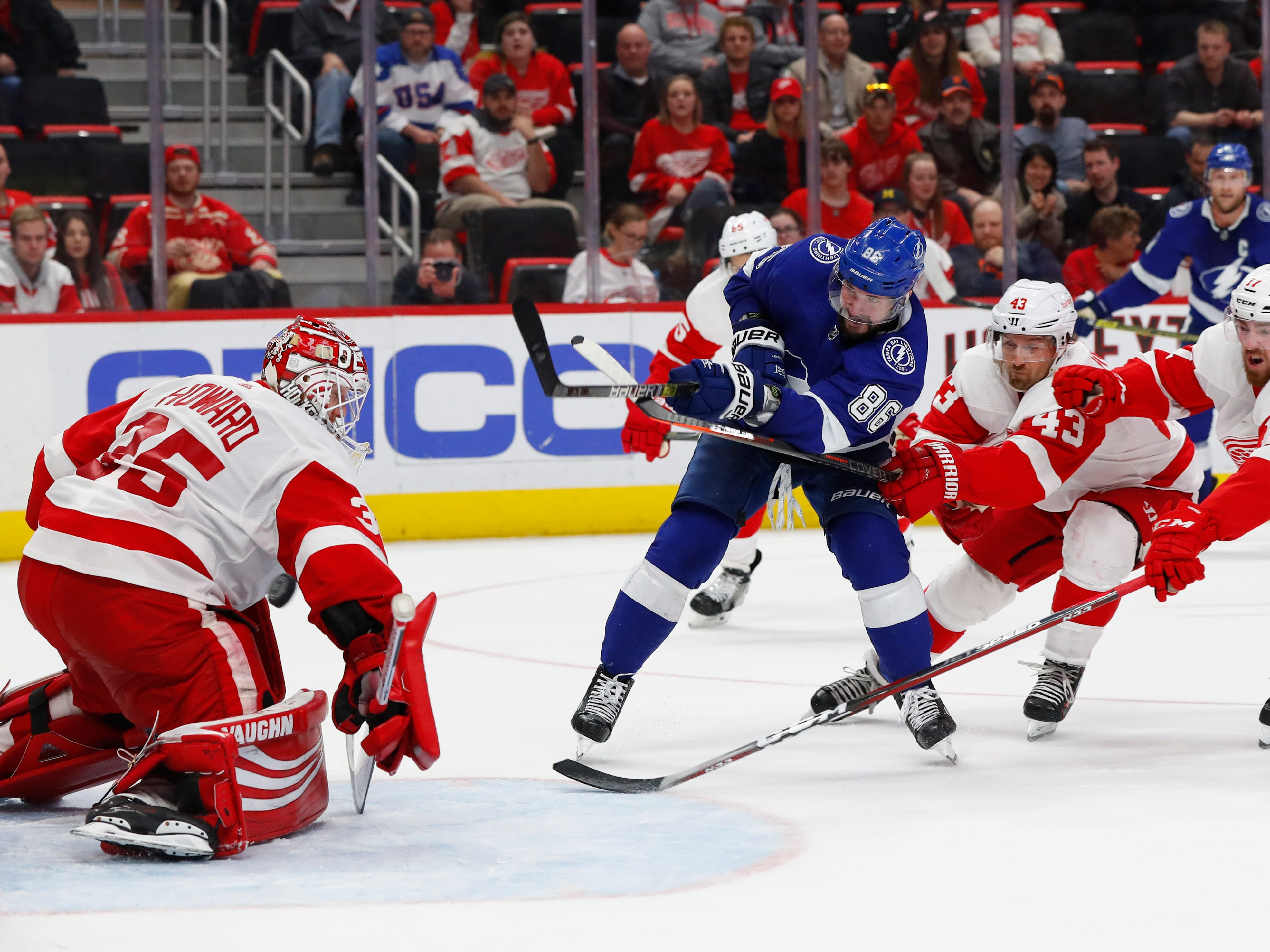 Tampa Bay Lightning's Nikita Kucherov (86) scores a goal on Detroit Red Wings goaltender Jimmy Howard (35) as Darren Helm (43) and Filip Hronek (17) defend in the third period.