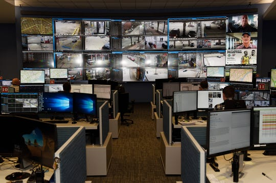 Crime analysts monitor multiple video screens for possible criminal behavior inside the Real-Time Crime Center at the Detroit Public Safety headquarters on Friday, March 15, 2019.
