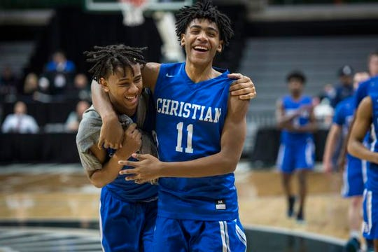 Southfield Christian's Tarron Carter, left, and Malcolm King celebrate their win after the game.