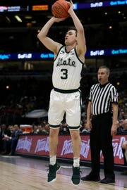 Michigan State's Foster Loyer (3) shoots a 3-point basket during the first half.